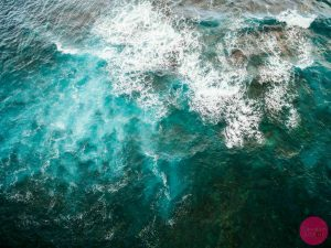 icy blue water at the punaluu black sand beach hawaii