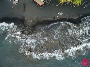 aerial drone view black sand beach