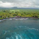 aerial photo of the black sand beach in hawaii