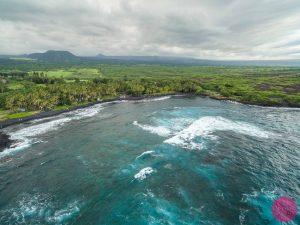 icy blue waves at the punaluu black sand beach big island hawaii