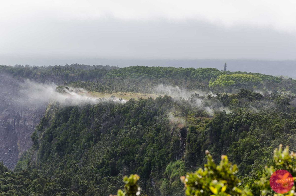After the rain, fumes arise from the cliffs around the Kilauea Caldera