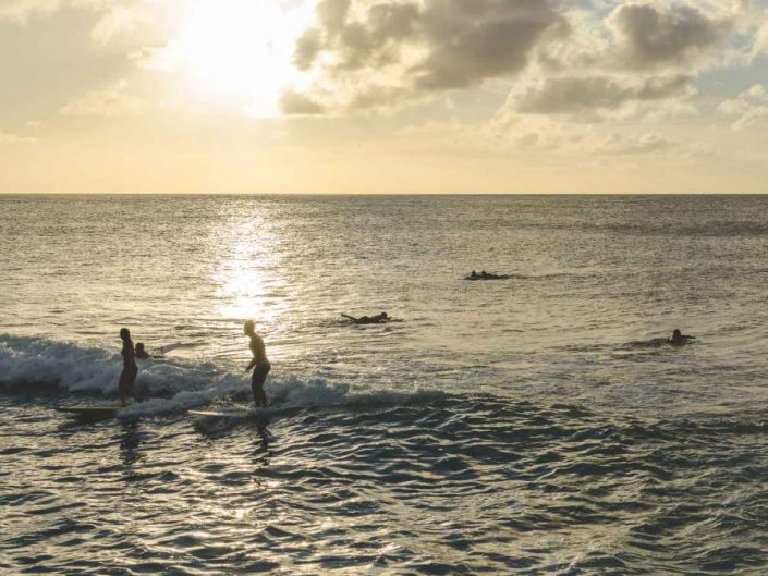 sunset surfers hawaii