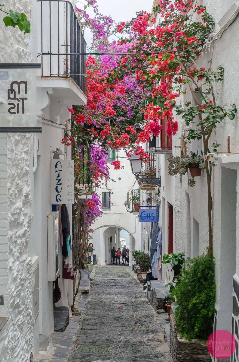 cadaques spain summer alley bougainvillea