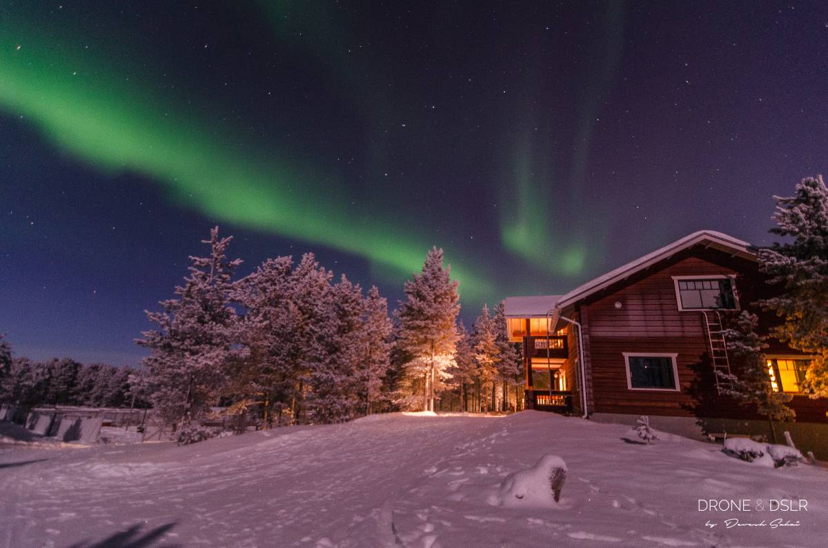 northern lights over a house in finland