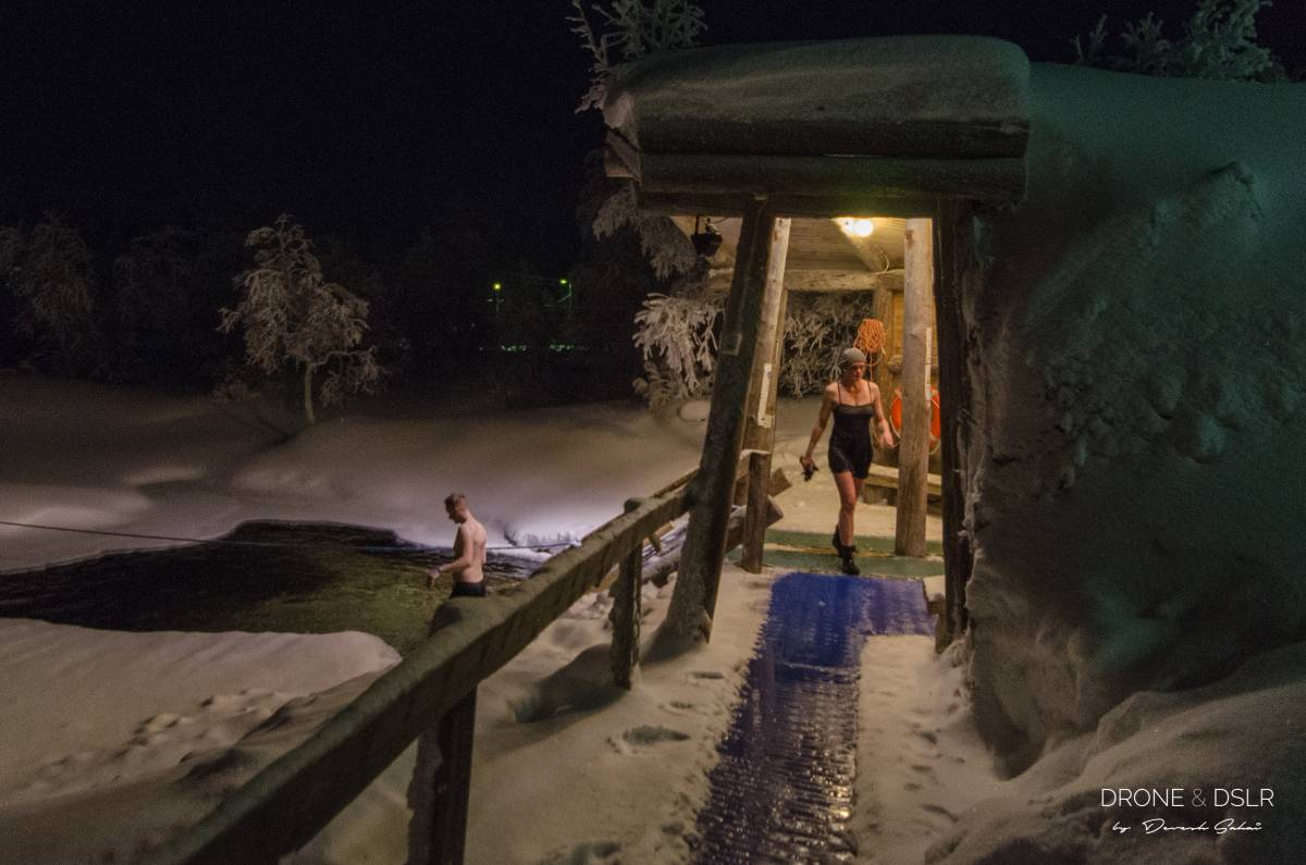 outside a tradtional Finnish smoke sauna where people take a dip in an ice lake